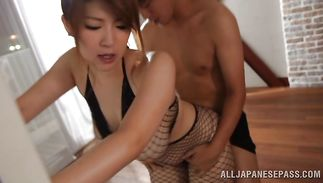 Ravishing busty Rina Araki gave a nice oral sex stimulation to dude while he was visiting her