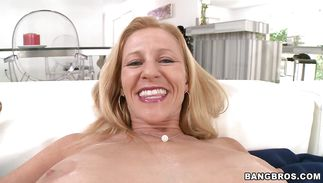 Blond mature Holly with firm tits is an angelic that can't live without to please customers