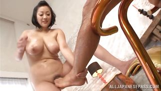 Sexually excited bosomed mature Minako Komukai has a smile on her face while being plowed