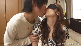 Horny mature girlfriend Aoi Aoyama with massive tits is gently rubbing her guy's rod