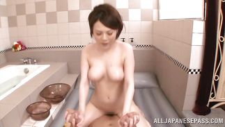 Salacious mature Rui Tsukimoto with great tits wraps her fat lips around a nice one-eyed monster