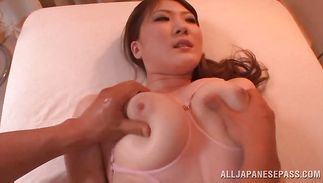 Enchanting perfection Momoka Nishina with massive tits is rubbing her love button while getting fucked hard by hunk