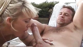 Luscious mature darling Hunter makes his one-eyed monster ready with her soft tits