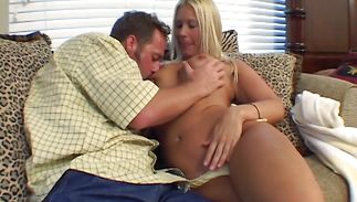 Heavenly Colleen sits on a jock and she rides it